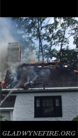 Gladwyne Firefighters Sam Leis and Mike Newell opening up the roof