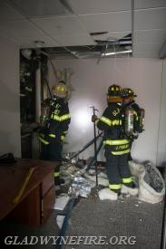 Gladwyne Firefighters opening up the 2nd floor walls where the fire was