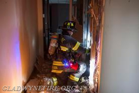 FF Sam Leis opening up the 2nd floor hallway.