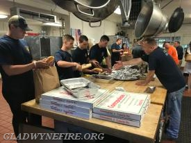 Gladwyne and Norristown Firefighters making dinner at MDA Camp