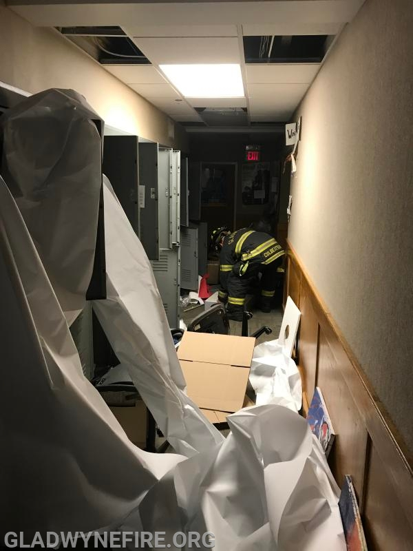 Senior firefighters clutter hallway before filling the area with smoke to provide extra challenges.