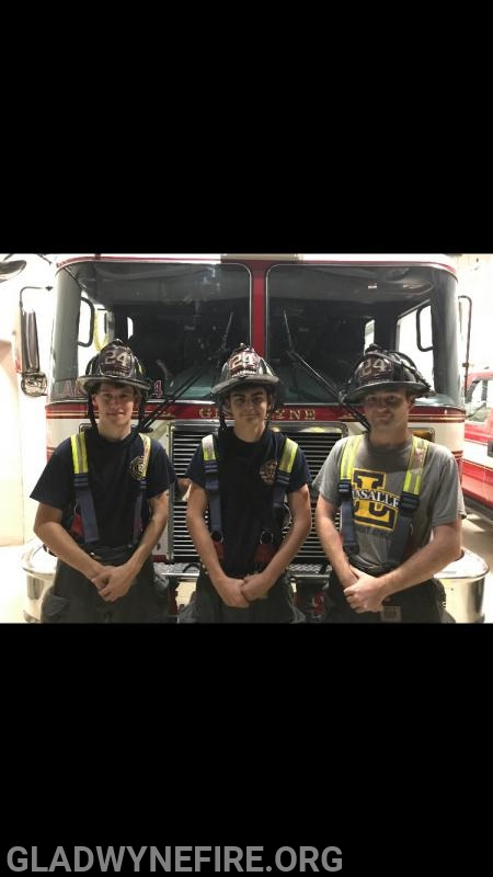 FF Fusaro, FF C Flanagan and FF P Flanagan after rescuing an occupant from the fire building